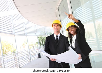 A young man and woman working on  construction site