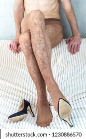 young man in women's nylon pantyhose and shoes with heels. Transsexuality. LGBT