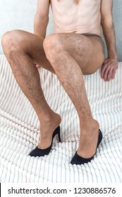 young man in women's nylon pantyhose and shoes with heels. Transsexuality