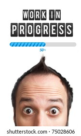 Young man with Work in progress sign over his head , isolated on white background