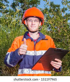 young man at work with thumbs up