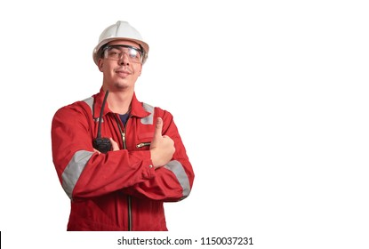 Young man worker  standing in red working overall, safety glasses and white helmet on a white isolated background