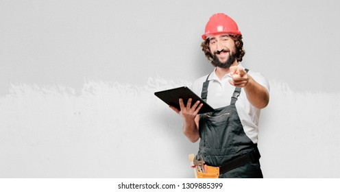young man worker with a tablet