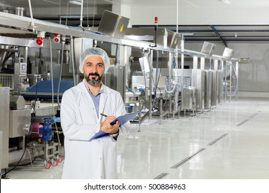 Young man working in food factory.
