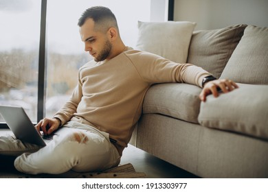 Young man working from home on laptop
