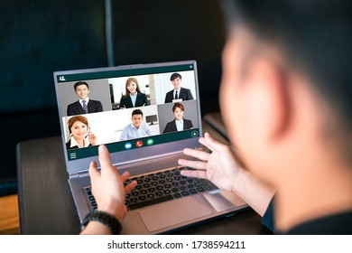 young man working at home and using laptop computer with video conference - Shutterstock ID 1738594211