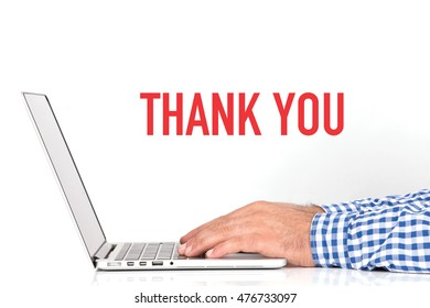 Young man working on desk and  THANK YOU concept on white background