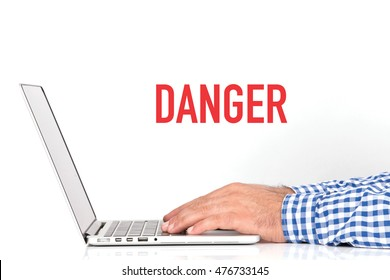 Young man working on desk and  DANGER concept on white background