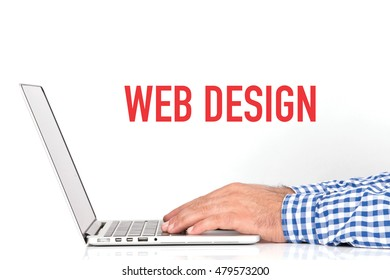 Young man working on desk and  WEB DESIGN concept on white background