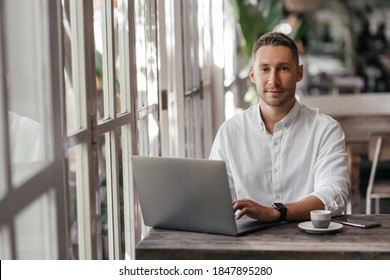 young man working on his computer at the cafe. business, freelance