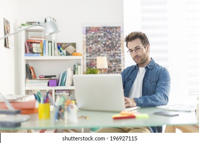 young man working on a laptop indoors