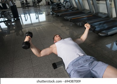Young Man Working Out Chest In Gym