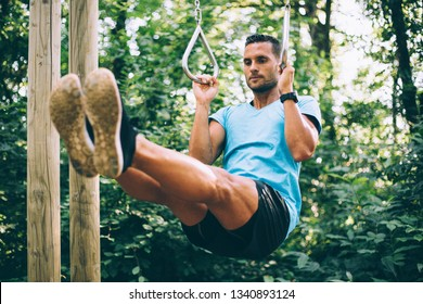 Young man working out in the woods