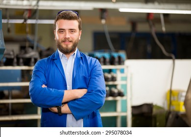 Young man working in shoes factory.