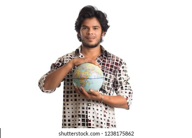 young man with a world globe on a white background.