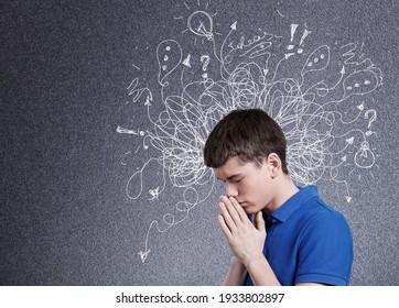 Junge Mann mit Besorgnis erregendem gestressten Gesichtsausdruck mit Illustration