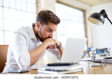 Young man worry about stock market in vintage loft office