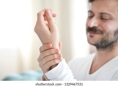 Young man with wrist pain