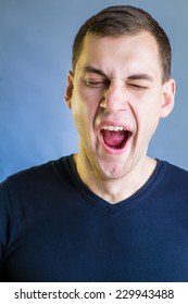 Young man yawing and late for work