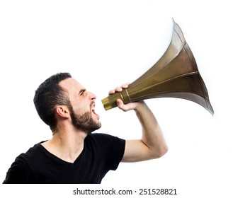 Young man yelling with a loudspeaker