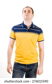 Young man with yellow polo shirt on a white background.