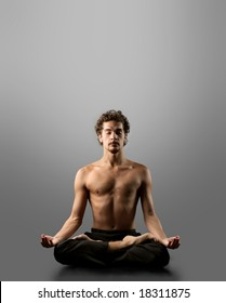 young man in yoga position