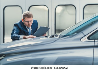 Young manager in garage