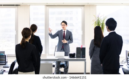 Young manager giving a speech. Group of businessperson in office.