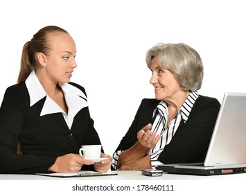 Young manager and her elderly collegue have a talk in office