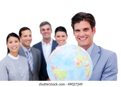 Young manager and his team holding a terrestrial globe against a white background