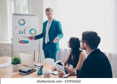 Young manager presenting whiteboard to his colleagues about financial growth
