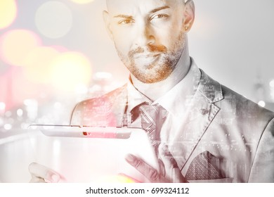 Young manager with tablet pc looking at camera double exposure