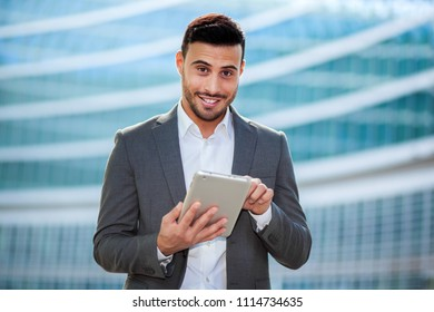 Young manager using a digital tablet outdoor in a modern urban setting