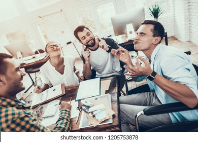 Young Managers Relaxing on Break in Modern Office. Smiling Woman. Man on Wheelchair. Smiling Worker. Communication with Colleagues. Fun in Office. Teamwork Concept. Relaxing at Work.