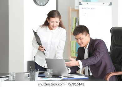 Young managers working in office