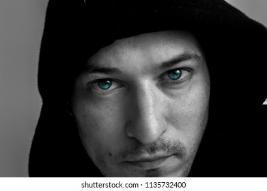 Young man's face with blue eyes