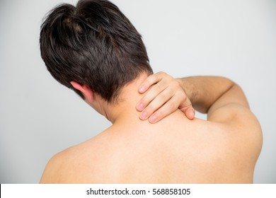 young man's neck and shoulders back view
