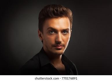 Young man's portrait. Close-up face.