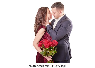 young married couple with a bouquet of red roses on a beige background on February 14 in Valentine's Day