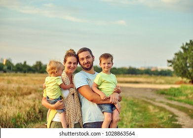 young married couple with children on a country walk