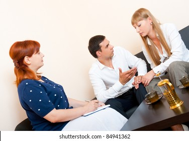 Young married couple consults at the psychologist