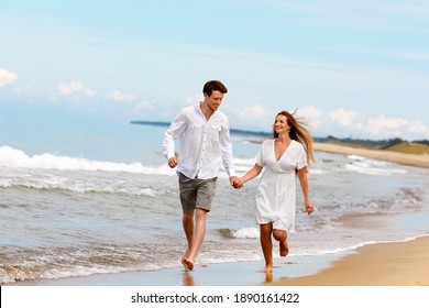 Young married couple enjoy the sea, good weather and communicating with each other on the beach on a Sunny summer day
