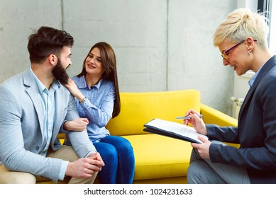 Young married couple at their financial advisor