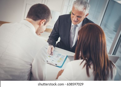 Young Married Couple With Their Financial Advisor