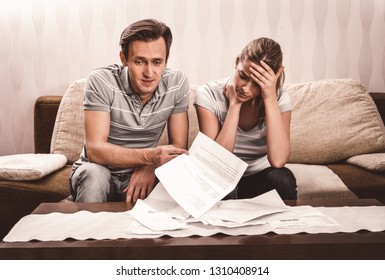 Young married couple are worried because of debts in bank. Financial problem.