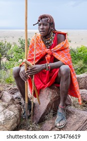Young Masai man sitting on the rock