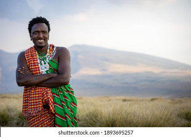 Young Masai Warrior with his ornaments and traditional clothes  enjoying his time outside his boma in the ngorongoro national park