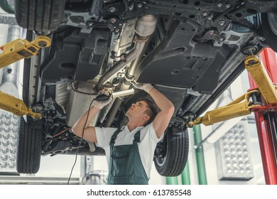 Young mechanic with lamp in service