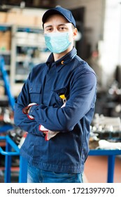 Young mechanic portrait wearing a mask