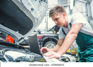 Young mechanic in service